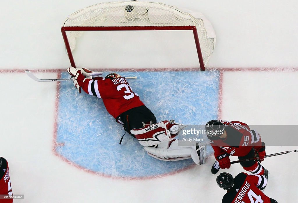 Cory Schneider #35 of the New Jersey Devils defends his net laying on the ice during the game against the Arizona Coyotes at Prudential Center on October 28, 2017 in Newark, New Jersey.
