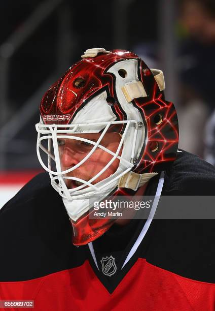 Cory Schneider of the New Jersey Devils looks on against the Columbus Blue Jackets during the game at Prudential Center on March 19 2017 in Newark...