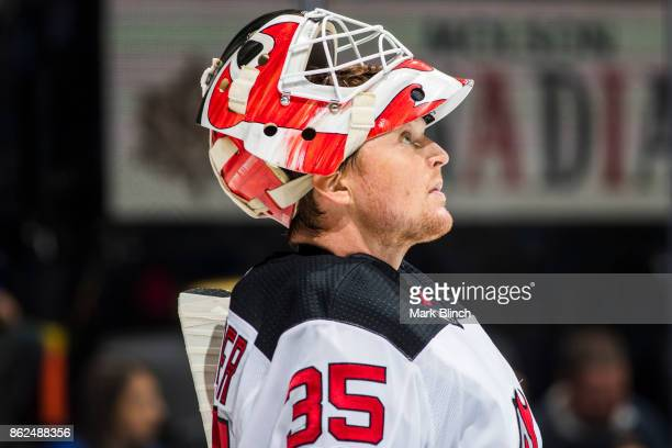 Cory Schneider of the New Jersey Devils looks on during break against the Toronto Maple Leafs during the first period at the Air Canada Centre on...