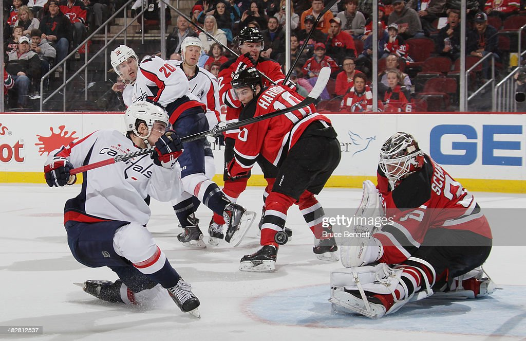 Cory Schneider of the New Jersey Devils makes a point blank save on Marcus Johansson of the Washington Capitals with less than three minutres...