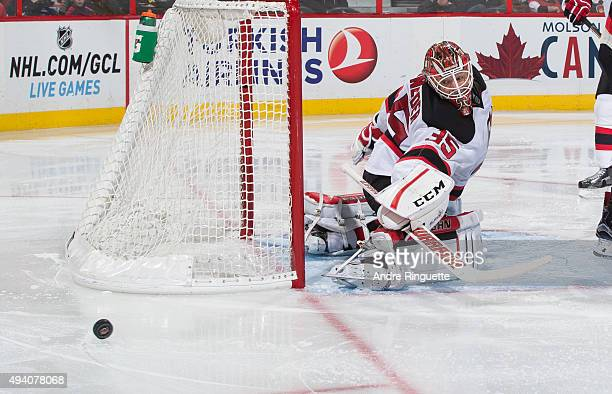 Cory Schneider of the New Jersey Devils makes a save against the Ottawa Senators at Canadian Tire Centre on October 22 2015 in Ottawa Ontario Canada
