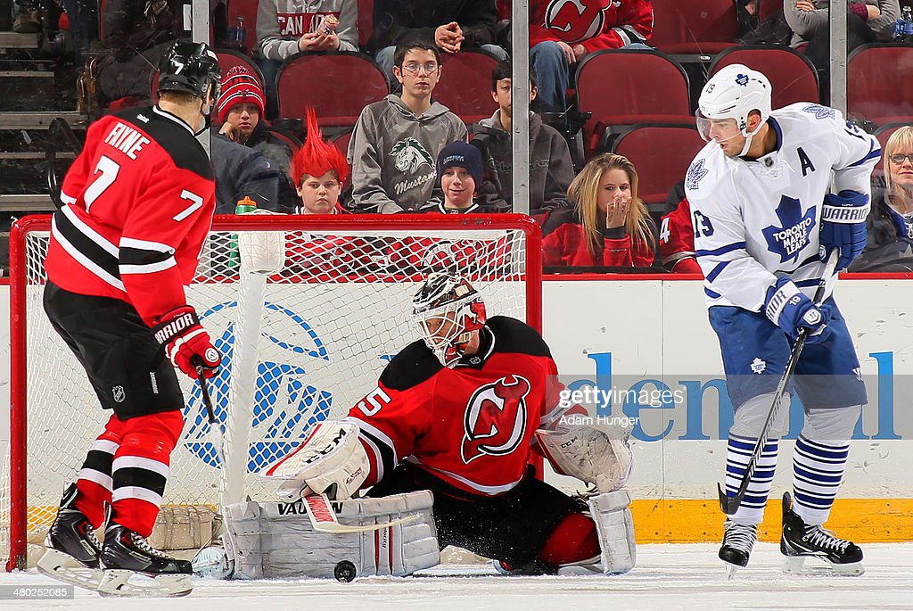 Cory Schneider #35 of the New Jersey Devils makes a save against the Toronto Maple Leafs during the third period at the Prudential Center on March 23, 2014 in Newark, New Jersey. The New Jersey Devils defeated the Toronto Maple Leafs 3-2.