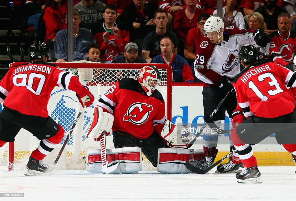 Cory Schneider #35 of the New Jersey Devils makes a save against the Colorado Avalanche during the Devils season opener at Prudential Center on October 7, 2017 in Newark, New Jersey.
