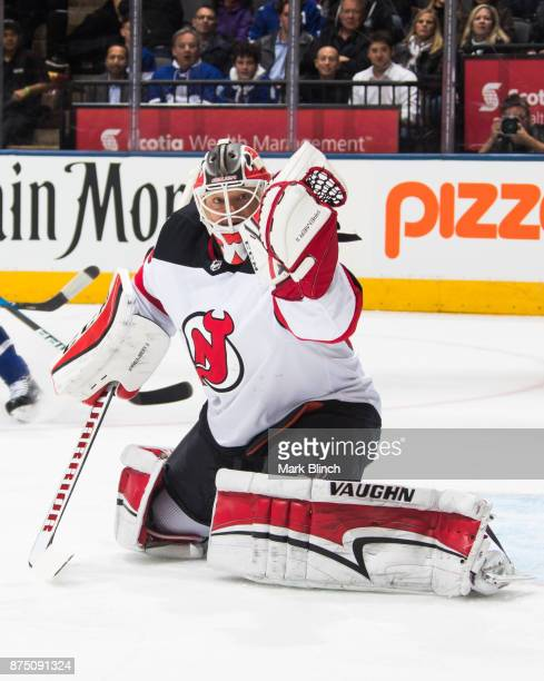 Cory Schneider of the New Jersey Devils makes a save during the first period against the Toronto Maple Leafs at the Air Canada Centre on November 16...