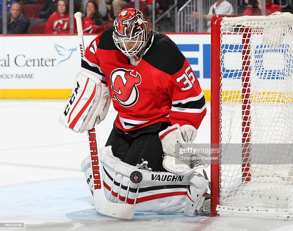 Cory Schneider #35 of the New Jersey Devils makes a save during the third period against the Columbus Blue Jackets at the Prudential Center on March 6, 2015 in Newark, New Jersey. The Blue Jackets defeated the Devils 3-2.
