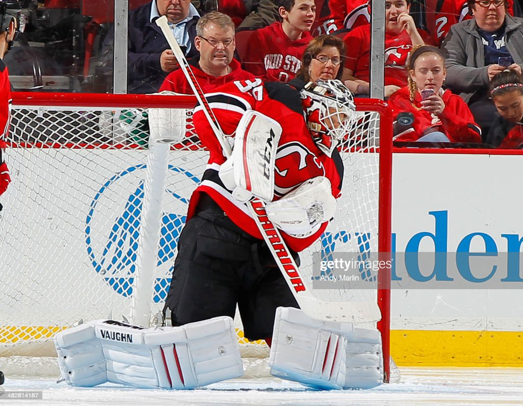 <a gi-track='captionPersonalityLinkClicked' href=/galleries/search?phrase=Cory+Schneider&family=editorial&specificpeople=696908 ng-click='$event.stopPropagation()'>Cory Schneider</a> #35 of the New Jersey Devils makes a shoulder save against the Washington Capitals during the game at the Prudential Center on April 4, 2014 in Newark, New Jersey.