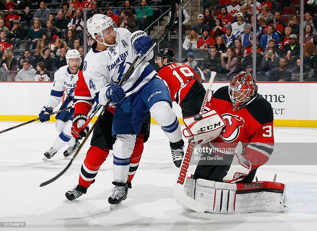<a gi-track='captionPersonalityLinkClicked' href=/galleries/search?phrase=Cory+Schneider&family=editorial&specificpeople=696908 ng-click='$event.stopPropagation()'>Cory Schneider</a> #35 of the New Jersey Devils makes the first period blocker save as <a gi-track='captionPersonalityLinkClicked' href=/galleries/search?phrase=Ryan+Callahan&family=editorial&specificpeople=809690 ng-click='$event.stopPropagation()'>Ryan Callahan</a> #24 of the Tampa Bay Lightning looks for the rebound at the Prudential Center on February 26, 2016 in Newark, New Jersey.