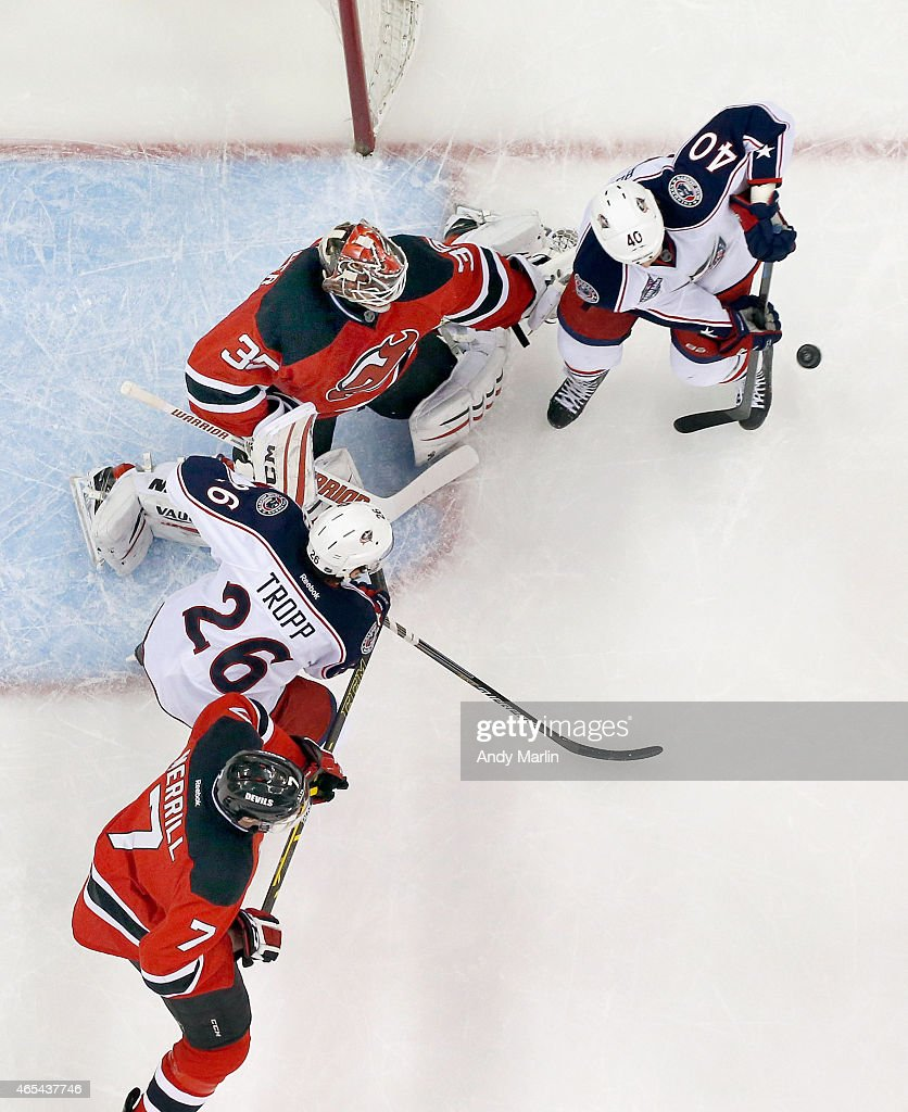 Cory Schneider #35 of the New Jersey Devils playing in his 200th career NHL game defends his net against the Columbus Blue Jackets during the game at the Prudential Center on March 6, 2015 in Newark, New Jersey.