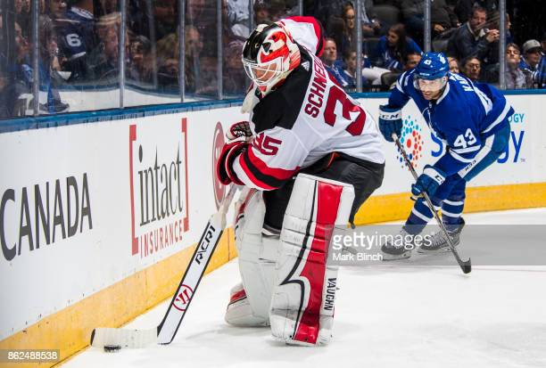 Cory Schneider of the New Jersey Devils plays the puck in front of Nazem Kadri of the Toronto Maple Leafs during the third period at the Air Canada...