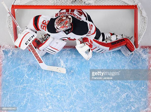 Cory Schneider of the New Jersey Devils protect the net against the Montreal Canadiens in the NHL game at the Bell Centre on November 28 2015 in...