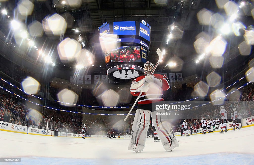 <a gi-track='captionPersonalityLinkClicked' href=/galleries/search?phrase=Cory+Schneider&family=editorial&specificpeople=696908 ng-click='$event.stopPropagation()'>Cory Schneider</a> #35 of the New Jersey Devils returns to the net following a timout during the game against the Ottawa Senators at the Prudential Center on December 17, 2014 in Newark, New Jersey.
