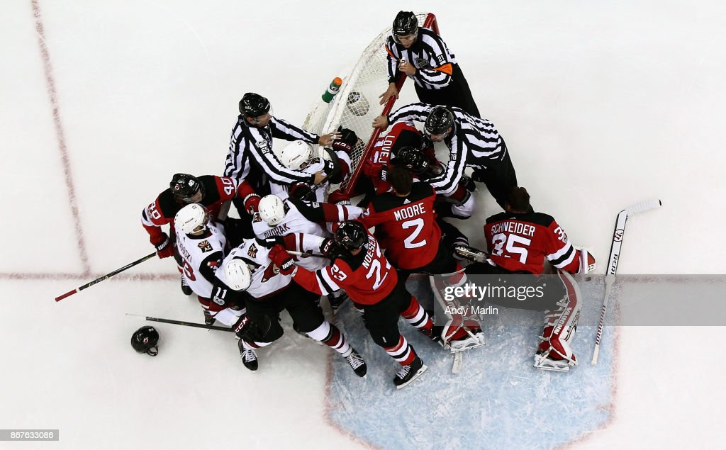 Cory Schneider #35 of the New Jersey Devils sits on his knees away from a melee during the game against the Arizona Coyotes at Prudential Center on October 28, 2017 in Newark, New Jersey.