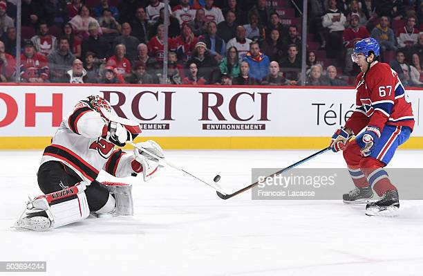 Cory Schneider of the New Jersey Devils stops a shot by Max Pacioretty of the Montreal Canadiens in the NHL game at the Bell Centre on January 6 2015...