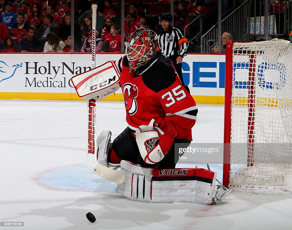 <a gi-track='captionPersonalityLinkClicked' href=/galleries/search?phrase=Cory+Schneider&family=editorial&specificpeople=696908 ng-click='$event.stopPropagation()'>Cory Schneider</a> #35 of the New Jersey Devils stops a shot in the third period against the Washington Capitals on February 6, 2016 at Prudential Center in Newark, New Jersey.The Washington Capitals defeated the New Jersey Devils 3-2 in an overtime shootout.
