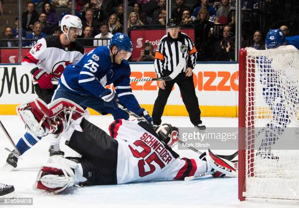 Cory Schneider of the New Jersey Devils stretches to make a save on James van Riemsdyk of the Toronto Maple Leafs during the first period at the Air...