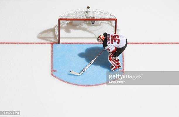 Cory Schneider of the New Jersey Devils takes the net against the Toronto Maple Leafs during the third period at the Air Canada Centre on October 11...