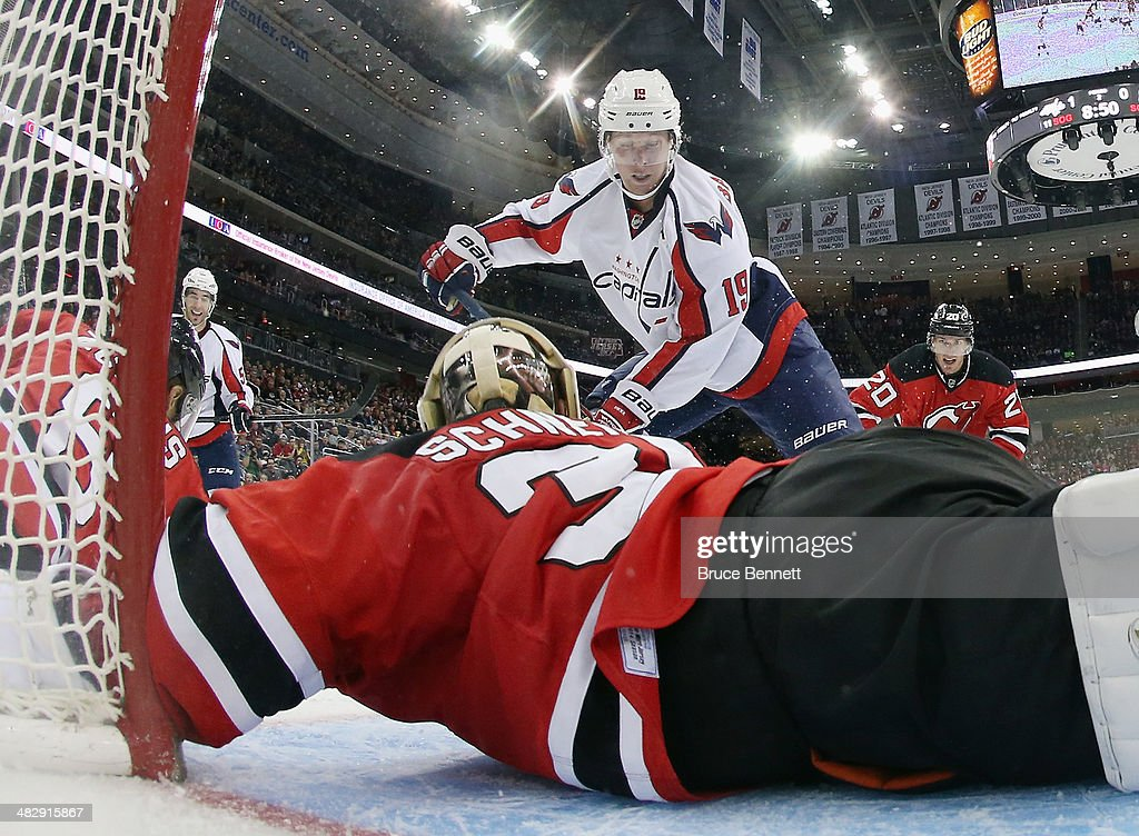 <a gi-track='captionPersonalityLinkClicked' href=/galleries/search?phrase=Cory+Schneider&family=editorial&specificpeople=696908 ng-click='$event.stopPropagation()'>Cory Schneider</a> #35 of the New Jersey Devils tends net against the Washington Capitals at the Prudential Center on April 4, 2014 in Newark, New Jersey. The Devils defeated the Capitals 2-1.