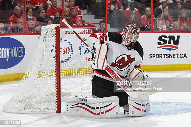 Cory Schneider of the New Jersey Devils watches the puck after making a save against the Ottawa Senators during an NHL game at Canadian Tire Centre...