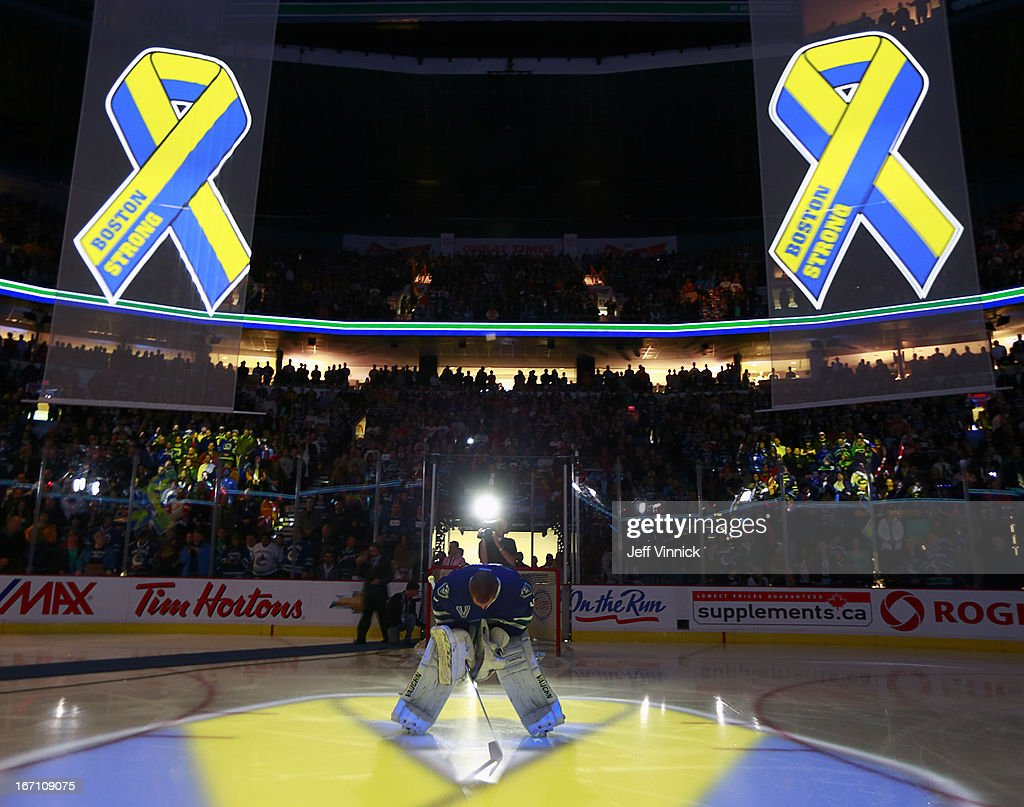 <a gi-track='captionPersonalityLinkClicked' href=/galleries/search?phrase=Cory+Schneider&family=editorial&specificpeople=696908 ng-click='$event.stopPropagation()'>Cory Schneider</a> #35 of the Vancouver Canucks bows down during a tribute to the victims of the Boston Marathon bombing before their NHL game against the Detroit Red Wings at Rogers Arena April 20, 2013 in Vancouver, British Columbia, Canada.