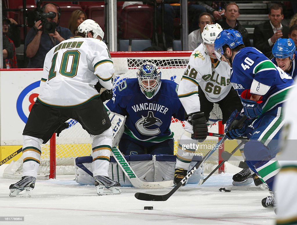 <a gi-track='captionPersonalityLinkClicked' href=/galleries/search?phrase=Cory+Schneider&family=editorial&specificpeople=696908 ng-click='$event.stopPropagation()'>Cory Schneider</a> #35 of the Vancouver Canucks gets a look through Jaromir Jagr #68 and <a gi-track='captionPersonalityLinkClicked' href=/galleries/search?phrase=Brenden+Morrow&family=editorial&specificpeople=202256 ng-click='$event.stopPropagation()'>Brenden Morrow</a> #10 of the Dallas Stars as <a gi-track='captionPersonalityLinkClicked' href=/galleries/search?phrase=Maxim+Lapierre&family=editorial&specificpeople=718385 ng-click='$event.stopPropagation()'>Maxim Lapierre</a> #40 of the Vancouver Canucks clears the puck during their NHL game at Rogers Arena February 15, 2013 in Vancouver, British Columbia, Canada. Dallas won 4-3.