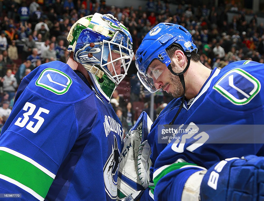 <a gi-track='captionPersonalityLinkClicked' href=/galleries/search?phrase=Cory+Schneider&family=editorial&specificpeople=696908 ng-click='$event.stopPropagation()'>Cory Schneider</a> #35 of the Vancouver Canucks is congratulated by teammate <a gi-track='captionPersonalityLinkClicked' href=/galleries/search?phrase=Maxim+Lapierre&family=editorial&specificpeople=718385 ng-click='$event.stopPropagation()'>Maxim Lapierre</a> #40 after their win over the Los Angeles Kings at Rogers Arena March 2, 2013 in Vancouver, British Columbia, Canada. Vancouver won 5-2.