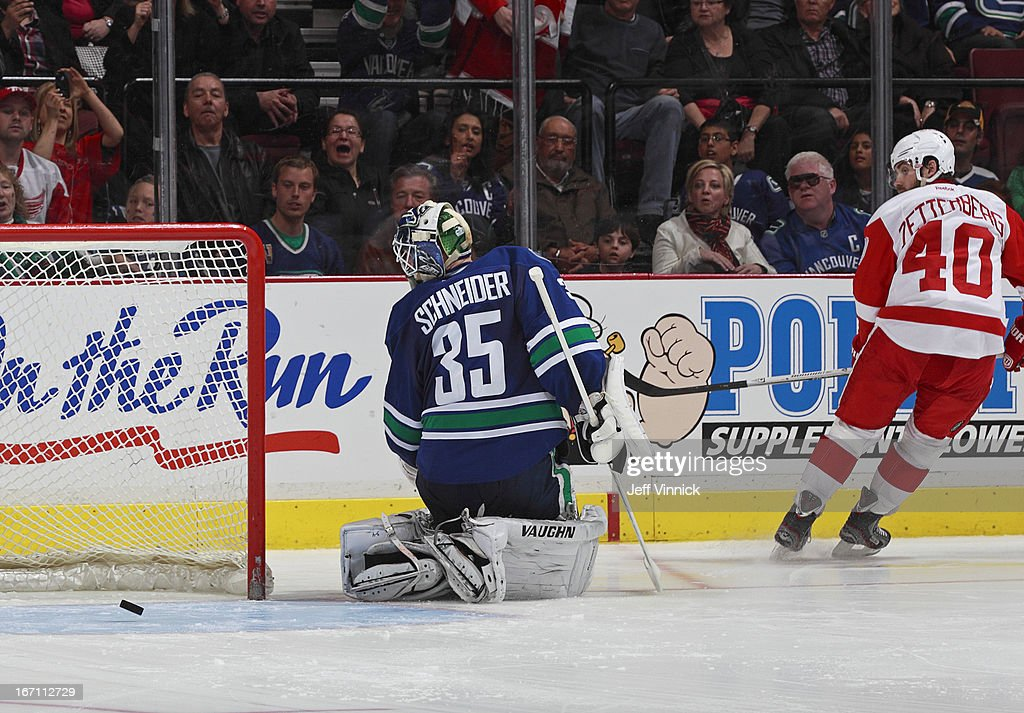 <a gi-track='captionPersonalityLinkClicked' href=/galleries/search?phrase=Cory+Schneider&family=editorial&specificpeople=696908 ng-click='$event.stopPropagation()'>Cory Schneider</a> #35 of the Vancouver Canucks looks back after making a shootout save on <a gi-track='captionPersonalityLinkClicked' href=/galleries/search?phrase=Henrik+Zetterberg&family=editorial&specificpeople=201520 ng-click='$event.stopPropagation()'>Henrik Zetterberg</a> #40 of the Detroit Red Wings during their NHL game at Rogers Arena April 20, 2013 in Vancouver, British Columbia, Canada. Vancouver won 2-1.