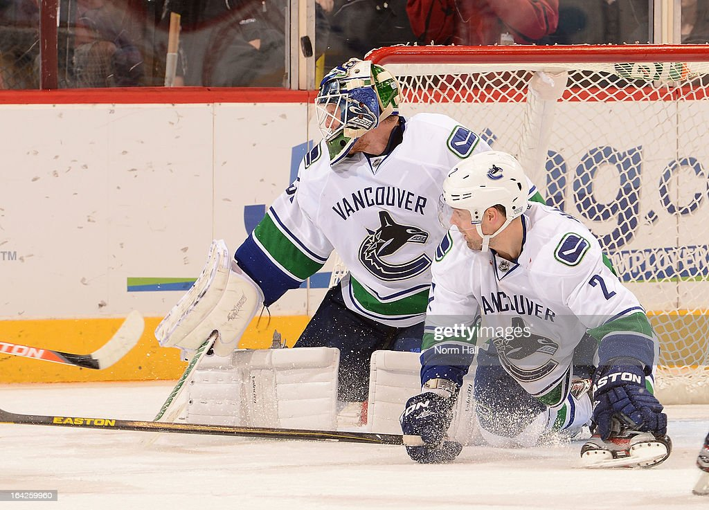 <a gi-track='captionPersonalityLinkClicked' href=/galleries/search?phrase=Cory+Schneider&family=editorial&specificpeople=696908 ng-click='$event.stopPropagation()'>Cory Schneider</a> #35 of the Vancouver Canucks makes a save as teammate Dan Hamhuis #2 looks to clear a rebound against the Phoenix Coyotes at Jobing.com Arena on March 21, 2013 in Glendale, Arizona.