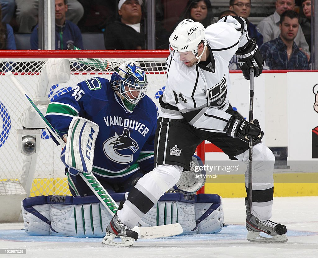 <a gi-track='captionPersonalityLinkClicked' href=/galleries/search?phrase=Cory+Schneider&family=editorial&specificpeople=696908 ng-click='$event.stopPropagation()'>Cory Schneider</a> #35 of the Vancouver Canucks makes a save on a deflection by Justin Williams #14 of the Los Angeles Kings during their NHL game at Rogers Arena March 2, 2013 in Vancouver, British Columbia, Canada. Vancouver won 5-2.