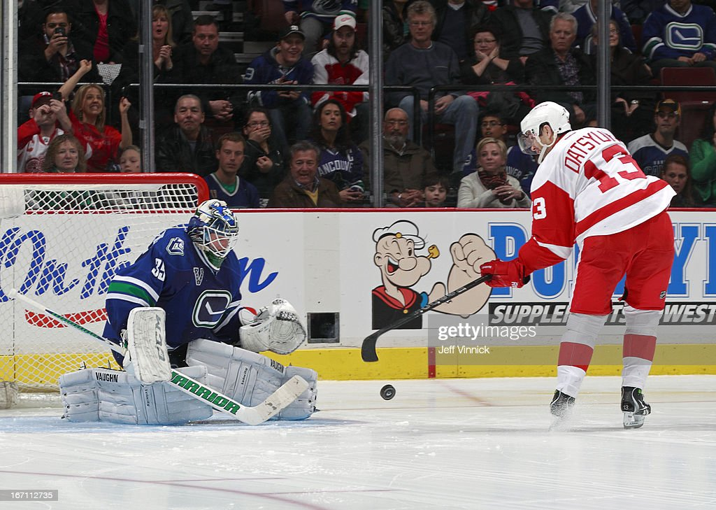 Cory Schneider #35 of the Vancouver Canucks makes a shootout save on Pavel Datsyuk #13 of the Detroit Red Wings during their NHL game at Rogers Arena April 20, 2013 in Vancouver, British Columbia, Canada. Vancouver won 2-1.