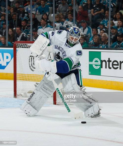 Cory Schneider of the Vancouver Canucks passes the puck against the San Jose Sharks in Game One of the Western Conference Quarterfinals during the...