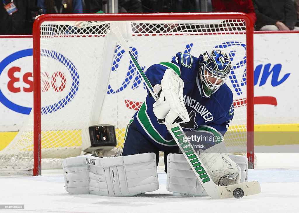<a gi-track='captionPersonalityLinkClicked' href=/galleries/search?phrase=Cory+Schneider&family=editorial&specificpeople=696908 ng-click='$event.stopPropagation()'>Cory Schneider</a> #35 of the Vancouver Canucks plays the puck against the Columbus Blue Jackets during their NHL game at Rogers Arena March 26, 2013 in Vancouver, British Columbia, Canada. Vancouver won 1-0.