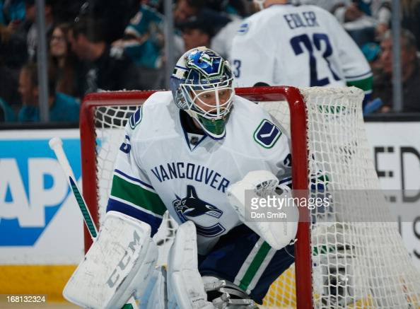 Cory Schneider of the Vancouver Canucks protects the net against the San Jose Sharks in Game One of the Western Conference Quarterfinals during the...