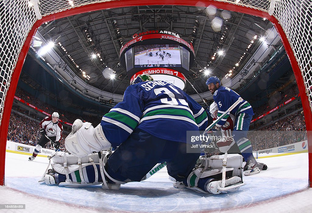 <a gi-track='captionPersonalityLinkClicked' href=/galleries/search?phrase=Cory+Schneider&family=editorial&specificpeople=696908 ng-click='$event.stopPropagation()'>Cory Schneider</a> #35 of the Vancouver Canucks reacts to a shot while <a gi-track='captionPersonalityLinkClicked' href=/galleries/search?phrase=Jason+Garrison&family=editorial&specificpeople=2143635 ng-click='$event.stopPropagation()'>Jason Garrison</a> #5 of the Canucks contains <a gi-track='captionPersonalityLinkClicked' href=/galleries/search?phrase=Jamie+McGinn&family=editorial&specificpeople=537964 ng-click='$event.stopPropagation()'>Jamie McGinn</a> #11 of the Colorado Avalanche during their NHL game at Rogers Arena March 28, 2013 in Vancouver, British Columbia, Canada. Vancouver won 4-1.