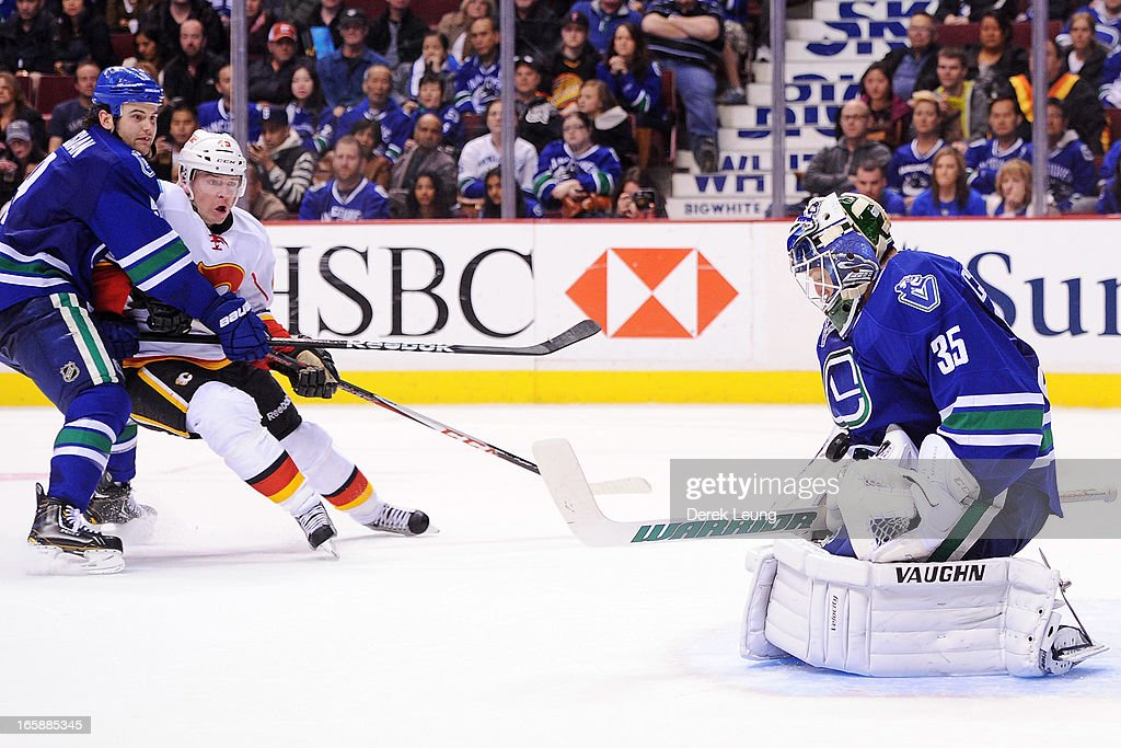 <a gi-track='captionPersonalityLinkClicked' href=/galleries/search?phrase=Cory+Schneider&family=editorial&specificpeople=696908 ng-click='$event.stopPropagation()'>Cory Schneider</a> #35 of the Vancouver Canucks stops the shot of <a gi-track='captionPersonalityLinkClicked' href=/galleries/search?phrase=Alex+Tanguay&family=editorial&specificpeople=203231 ng-click='$event.stopPropagation()'>Alex Tanguay</a> #40 of the Calgary Flames during an NHL game at Rogers Arena on April 6, 2013 in Vancouver, British Columbia, Canada. The Vancouver Canucks won 5-2.