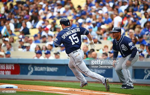 Cory Spangenberg of the San Diego Padres approaches first base on after hitting a double to left in the first inning as first base coach first base...