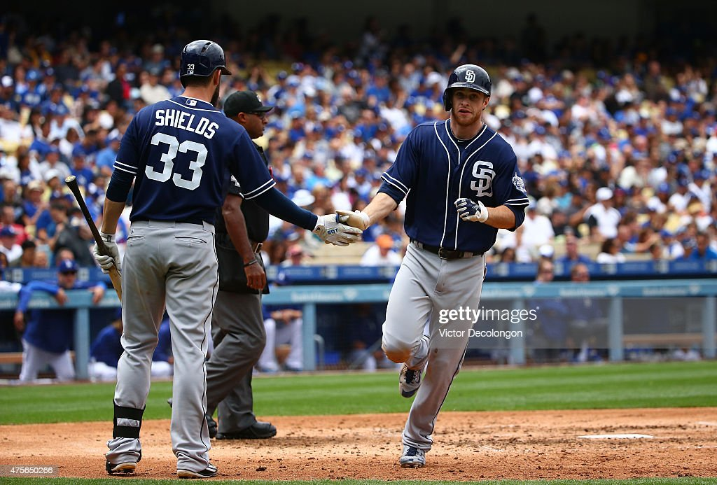<a gi-track='captionPersonalityLinkClicked' href=/galleries/search?phrase=Cory+Spangenberg&family=editorial&specificpeople=12495171 ng-click='$event.stopPropagation()'>Cory Spangenberg</a> #15 of the San Diego Padres is congratulated by teammate <a gi-track='captionPersonalityLinkClicked' href=/galleries/search?phrase=James+Shields+-+Jogador+de+basebol&family=editorial&specificpeople=8138267 ng-click='$event.stopPropagation()'>James Shields</a> #33 after scoring in the fifth inning during the MLB game against the San Diego Padres at Dodger Stadium on May 24, 2015 in Los Angeles, California. The Padres defeated the Dodgers 11-3.