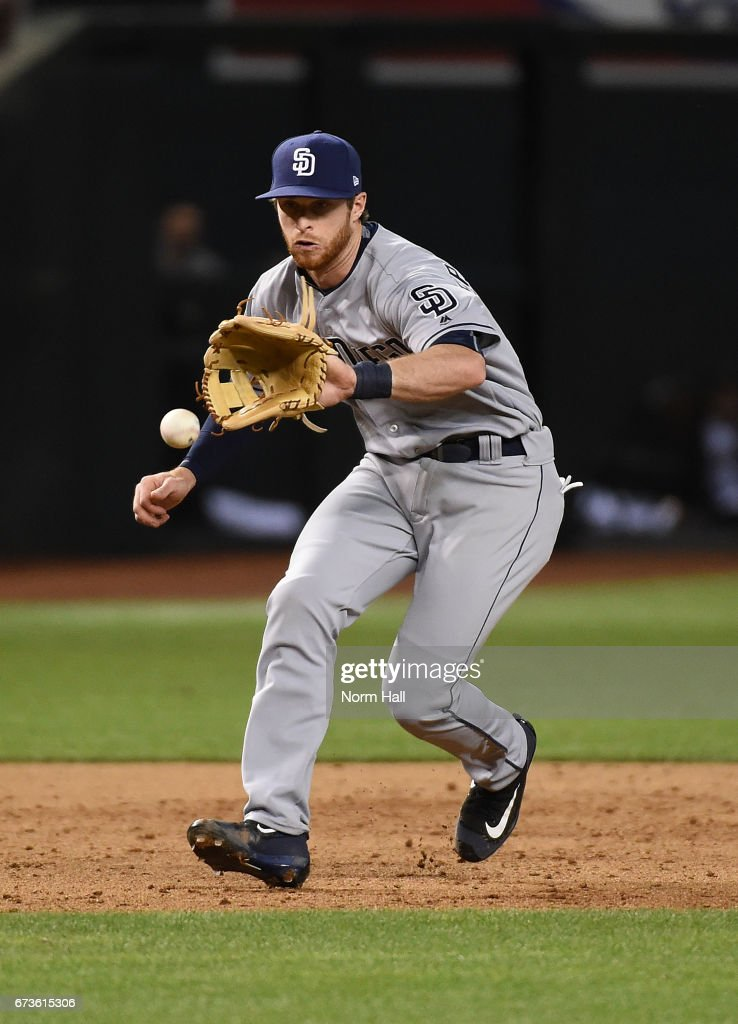 Cory Spangenberg #15 of the San Diego Padres makes a play on a bouncing ball against the Arizona Diamondbacks at Chase Field on April 26, 2017 in Phoenix, Arizona. Padres won 8-5.