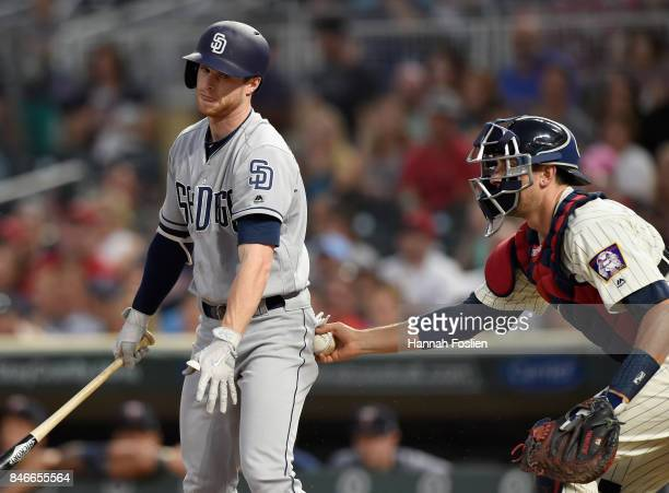 Cory Spangenberg of the San Diego Padres reacts to striking out as Jason Castro of the Minnesota Twins applies the tag during the second inning of...