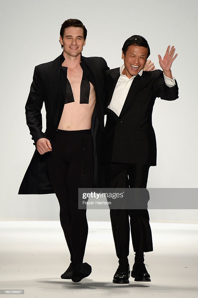 Cory Stearns and designer Zang Toi walk the runway at the Zang Toi fashion show during Mercedes-Benz Fashion Week Spring 2014 on September 10, 2013 in New York City.