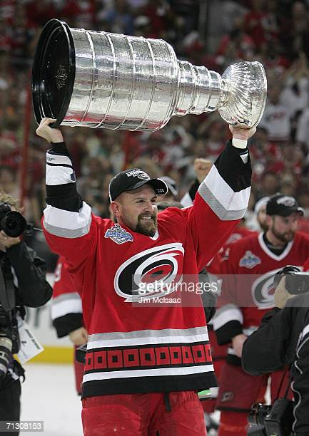 Cory Stillman of the Carolina Hurricanes hoists the Stanley Cup after the Hurricanes defeated the Edmonton Oilers in game seven of the 2006 NHL...