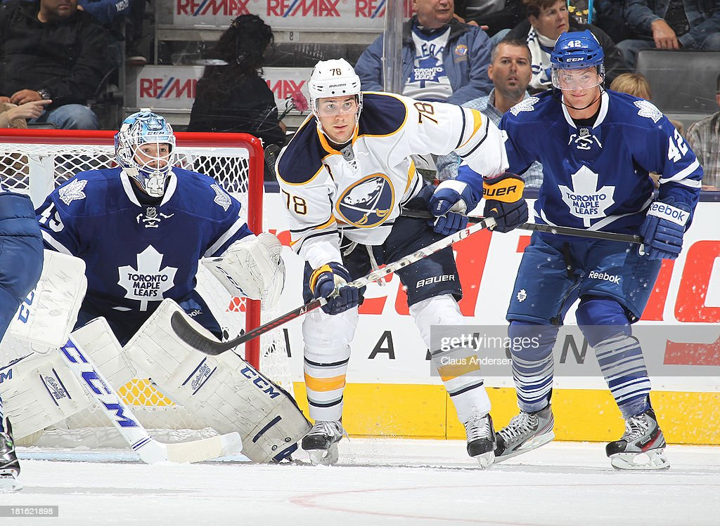 Cory Tropp #78 of the Buffalo Sabres stands between <a gi-track='captionPersonalityLinkClicked' href=/galleries/search?phrase=Jonathan+Bernier&family=editorial&specificpeople=540491 ng-click='$event.stopPropagation()'>Jonathan Bernier</a> #45 and <a gi-track='captionPersonalityLinkClicked' href=/galleries/search?phrase=Tyler+Bozak&family=editorial&specificpeople=6183313 ng-click='$event.stopPropagation()'>Tyler Bozak</a> #42 of the Toronto Maple Leafs in a pre-season game on Sept 22, 2013 at the Air Canada Centre in Toronto, Ontario, Canada. The Leafs defeated the Sabres 5-3.