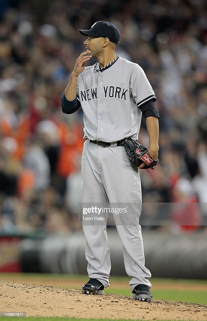 <a gi-track='captionPersonalityLinkClicked' href=/galleries/search?phrase=Cory+Wade&family=editorial&specificpeople=5314756 ng-click='$event.stopPropagation()'>Cory Wade</a> #53 of the New York Yankees watches <a gi-track='captionPersonalityLinkClicked' href=/galleries/search?phrase=Miguel+Cabrera&family=editorial&specificpeople=202141 ng-click='$event.stopPropagation()'>Miguel Cabrera</a> #24 of the Detroit Tigers ball clear the center field fence during the eighth inning of the game at Comerica Park on June 2, 2012 in Detroit, Michigan. The Tigers defeated the Yankees 4-3.