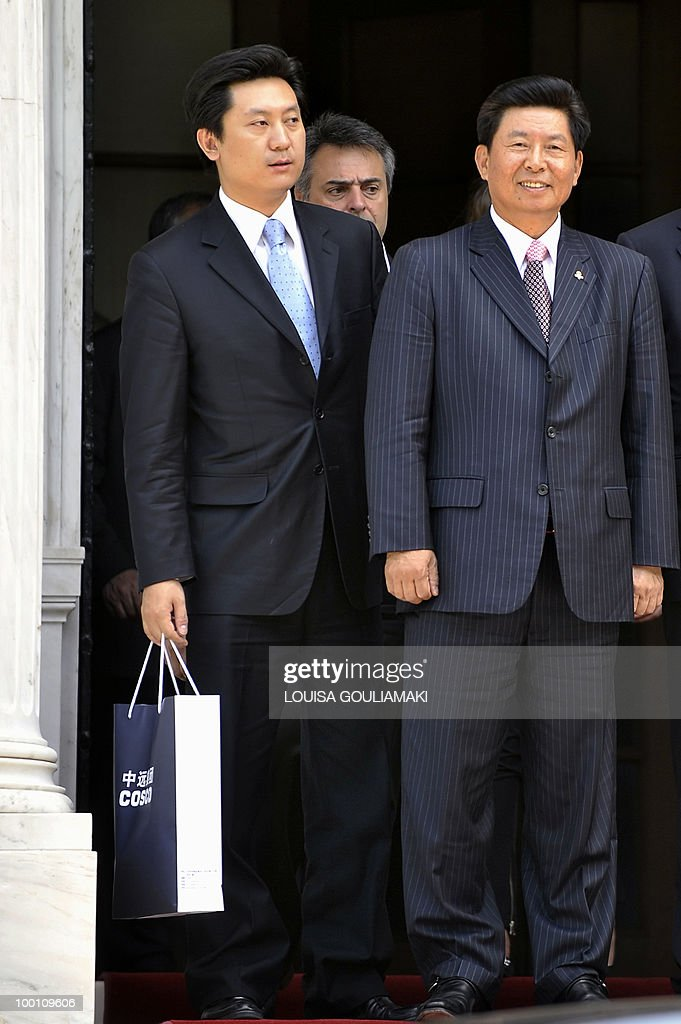 Cosco chairman and CEO Wei Jiafu (R) leaves the Prime Minister's office in Athens after his meeting with George Papandreou on May 21, 2010.Greece has told Chinese shipping giant Cosco that strikes which frequently cripple business in the country will not affect a 35-year port concession vital to its debt-hit economy, Cosco said Friday. AFP PHOTO / Louisa Gouliamaki
