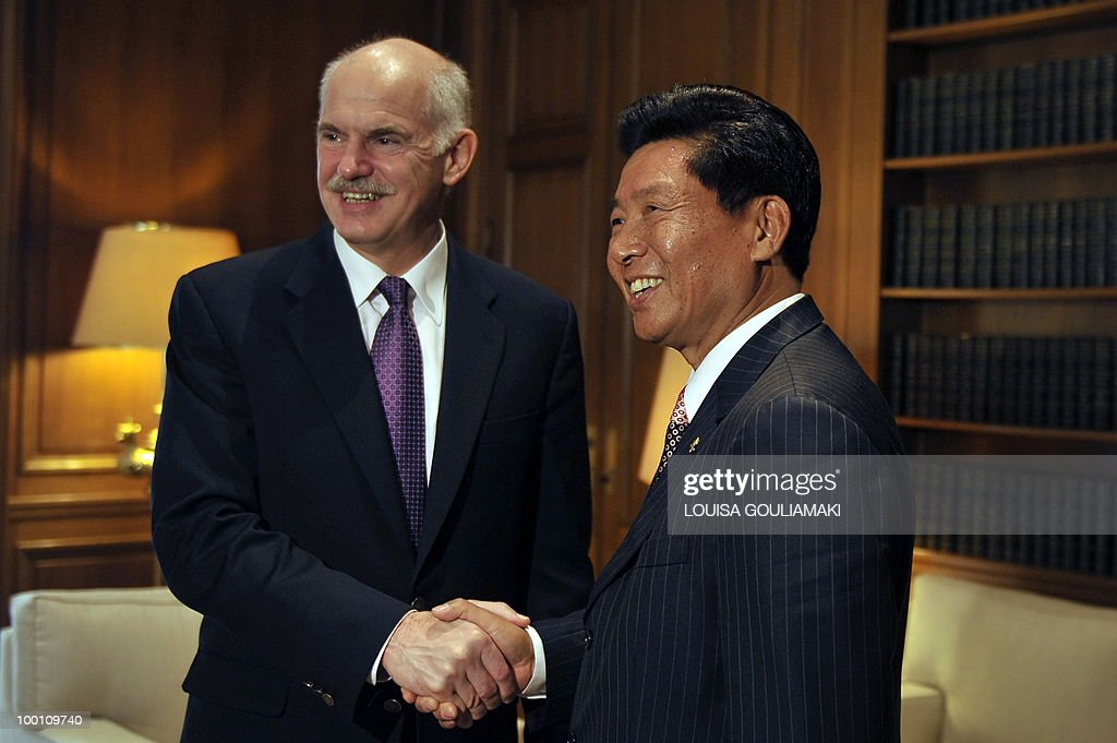 Cosco chairman and CEO Wei Jiafu (R) shakes hands with Greek prime minister George Papandreou during their meeting in Athens on May 21, 2010.Greece has told Chinese shipping giant Cosco that strikes which frequently cripple business in the country will not affect a 35-year port concession vital to its debt-hit economy, Cosco said Friday. AFP PHOTO / Louisa Gouliamaki