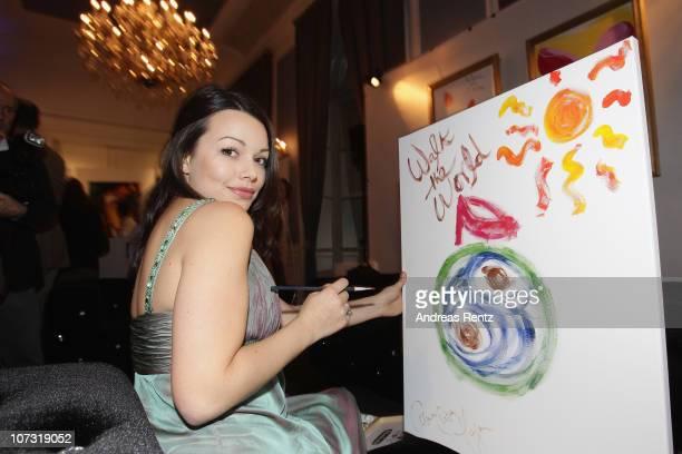 Cosma Shiva Hagen paints during the 'Movie meets Media' Night at Hotel Atlantic on December 3 2010 in Hamburg Germany