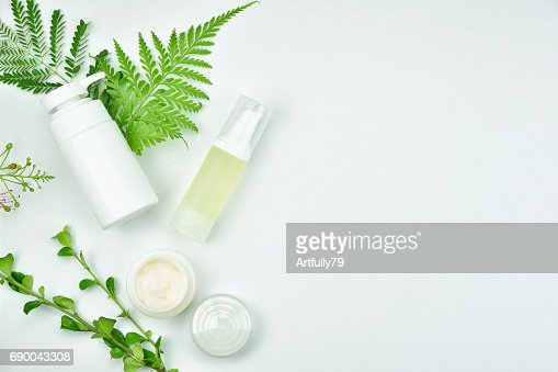 Cosmetic bottle containers with green herbal leaves, Blank label package for branding mock-up, Natural organic beauty product concept. : Stock Photo