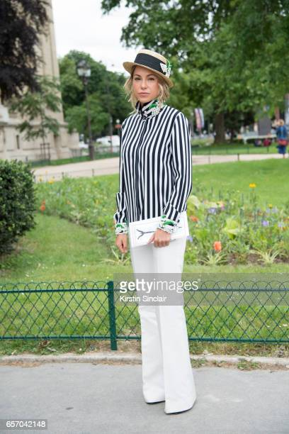 Cosmetic brand owner Anna Kovalchuk wears an Alexander Arutyunov shirt trousers and hat on day 3 of Paris Haute Couture Fashion Week Autumn/Winter...
