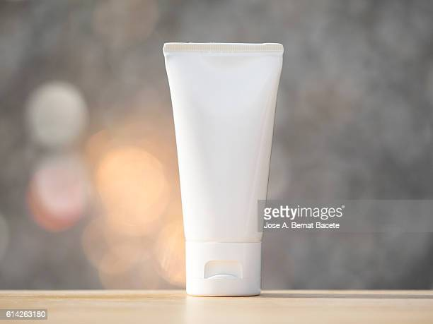 Cosmetic plastic tube blank, close up, illuminated by sunlight