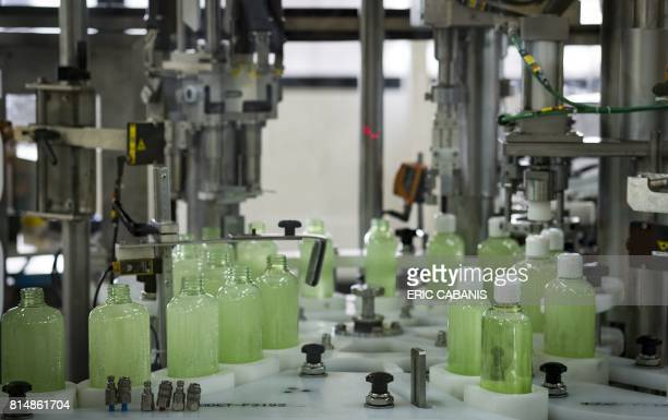 Cosmetic products are prepared on the production line at the plant of French multinational pharmaceutical and cosmetics company 'Pierre Fabre' in...