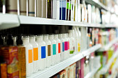 Cosmetic section with conditioners, shampoo and hair treatment in store